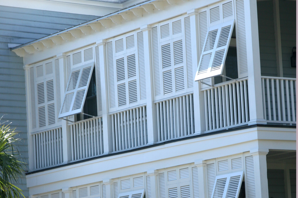 Shutters roll shutters bahama shutters secuirty screens for Beachy exterior shutters